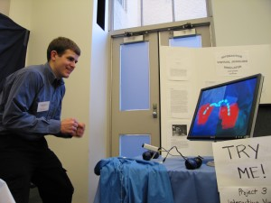David demonstrates the Interactive Virtual Juggling Simulator at the course 6 project expo.